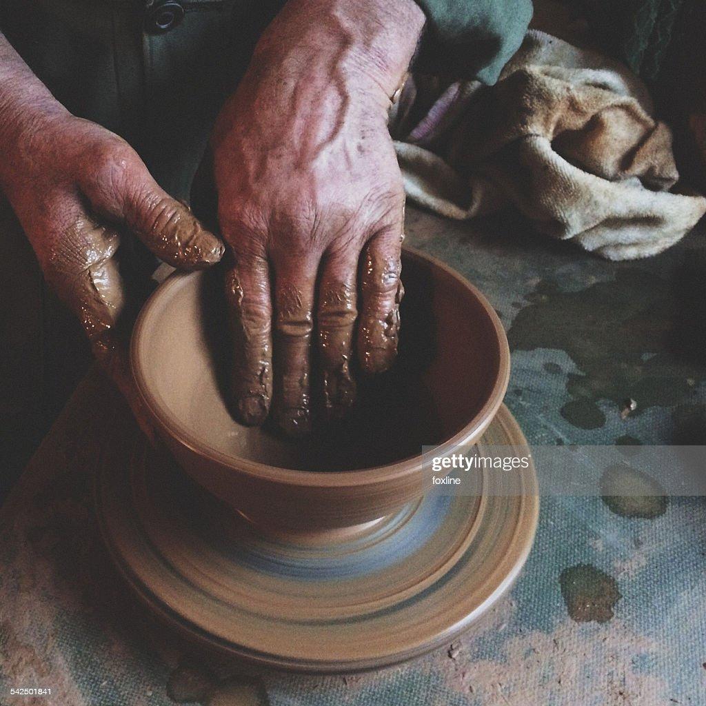 Close-up of man making pottery : Stock Photo