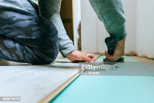 Closeup Of Man Placing Parquet Floor Stock Photo - Getty Images