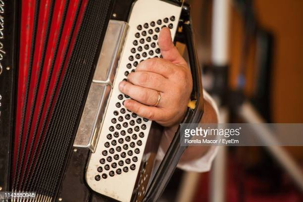 close-up of man playing accordion - musical equipment stock pictures, royalty-free photos & images