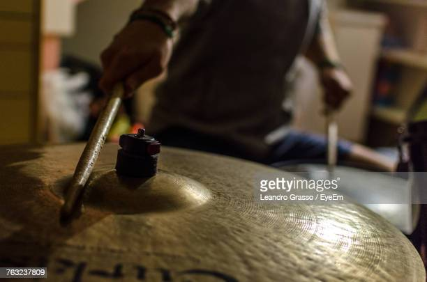 close-up of man playing cymbal - percussion instrument stock photos and pictures