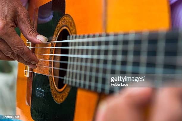 close-up of man playing flamenco on guitar - musical instrument string stock pictures, royalty-free photos & images