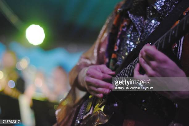 close-up of man playing guitar - stars and strings concert stock photos and pictures