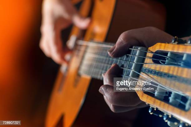 close-up of man playing guitar - classical guitar stock photos and pictures