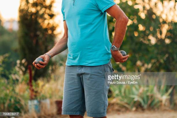 Close-Up Of Man Playing Petanque