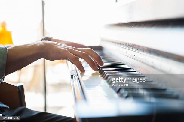 close-up of man playing piano - piano player stock photos and pictures