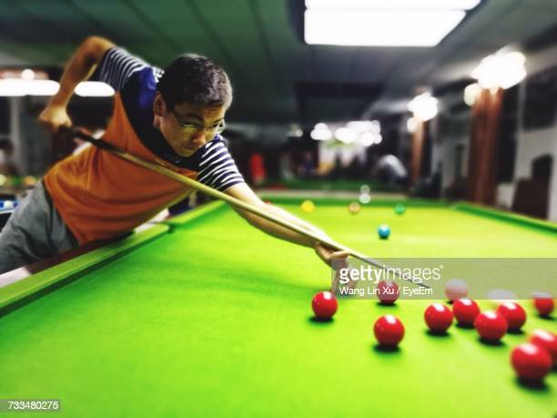 Close-Up Of Man Playing Pool