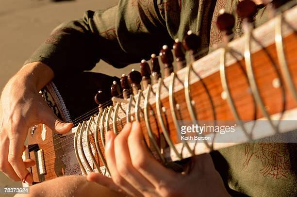 Close-up of man playing sitar
