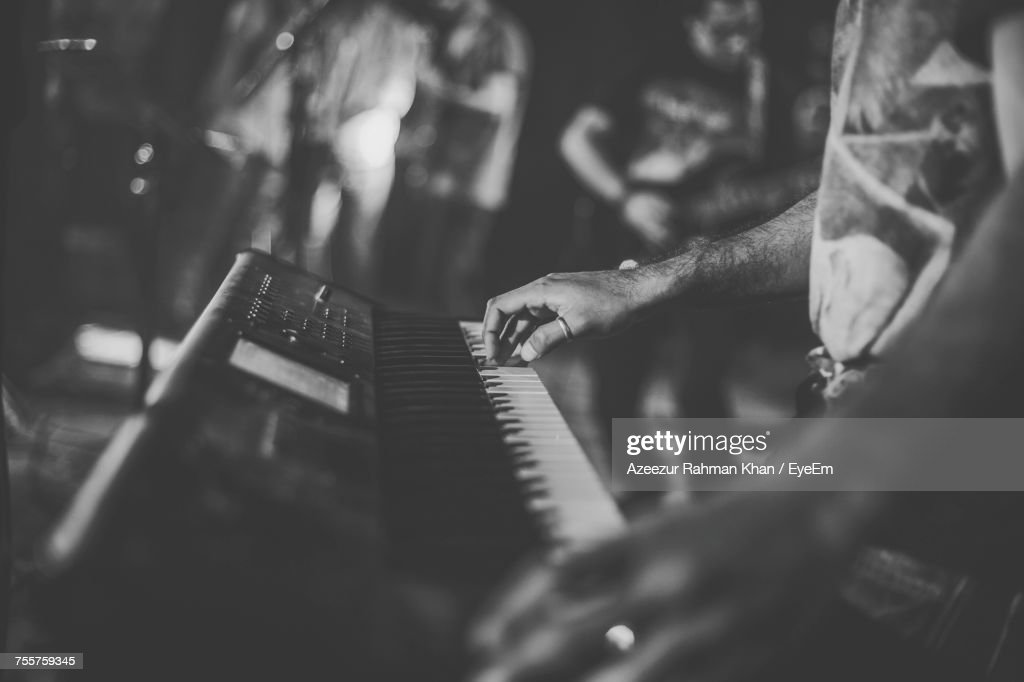 Close-Up Of Man Playing Synth : Stock Photo