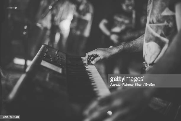 close-up of man playing synth - keyboard player stock photos and pictures