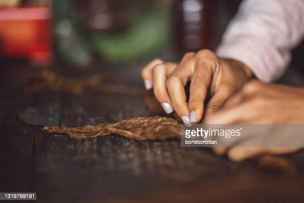 close-up of man preparing food on table - bortes stock-fotos und bilder