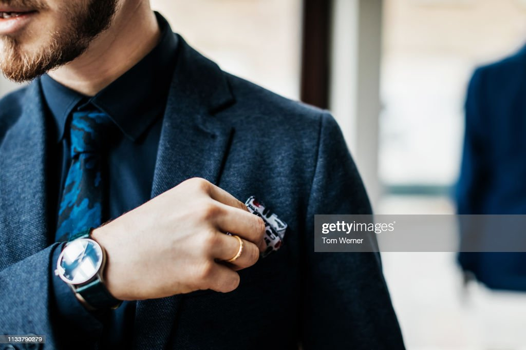Close-Up Of Man Putting Handkerchief In Poket : ストックフォト