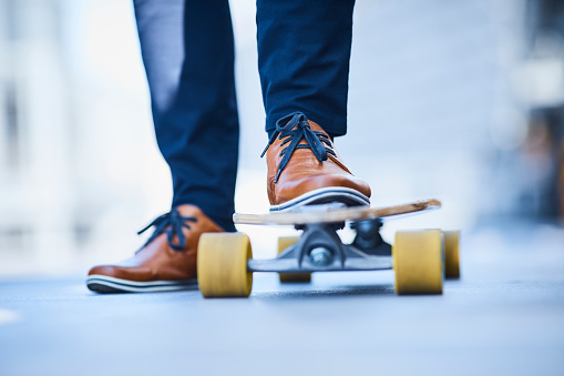 Close-up of man riding longboard - gettyimageskorea