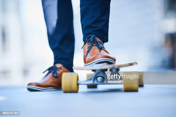 Close-up of man riding longboard
