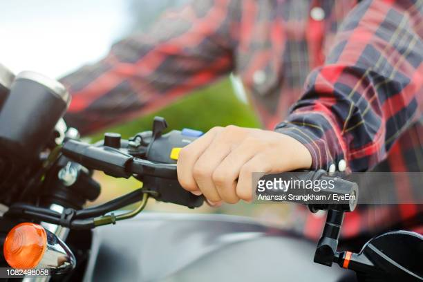 close-up of man riding motorcycle - handlebar stock pictures, royalty-free photos & images