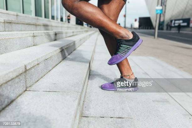 close-up of man running up stairs - black men feet stock photos and pictures