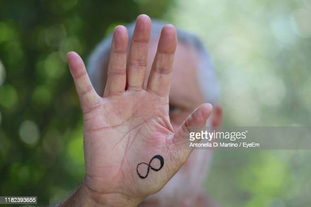 close-up of man showing hand - antonella di martino foto e immagini stock