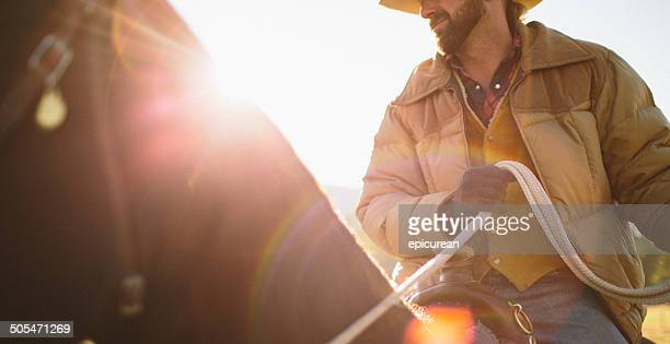 Close-up  of man sitting on horse with sunglare