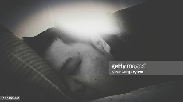 Close-Up Of Man Sleeping In Bed At Morning