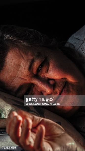 Close-Up Of Man Sleeping On Bed