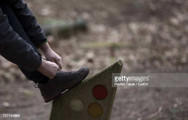 close-up of man tying shoes - paulien tabak stock pictures, royalty-free photos & images