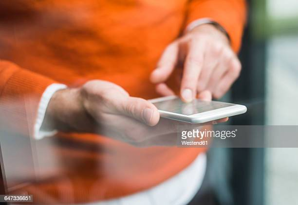 Close-up of man using smartphone
