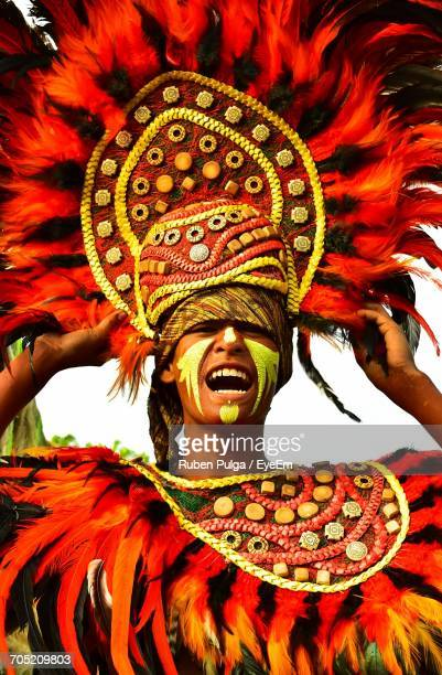 close-up of man wearing costume at tribu salognon dinagyang festival - dinagyang festival stock photos and pictures