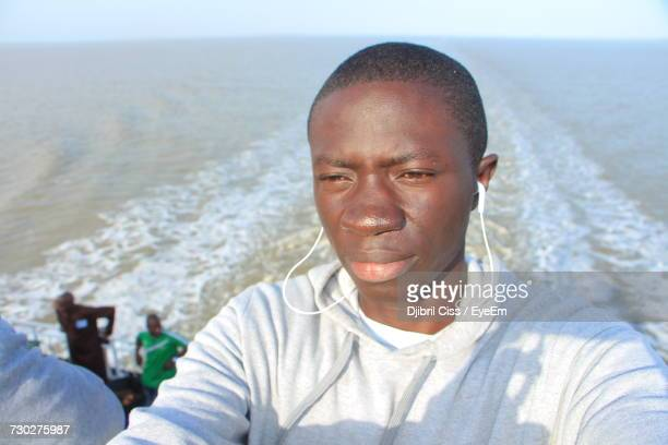 Close-Up Of Man Wearing Headphones On Boat