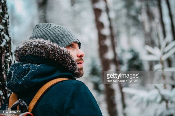 close-up of man wearing knit hat during winter - only mid adult men stock pictures, royalty-free photos & images