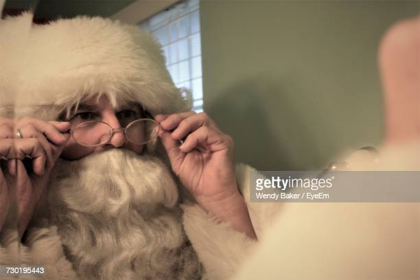 close-up of man wearing santa claus costume - santa close up stock pictures, royalty-free photos & images