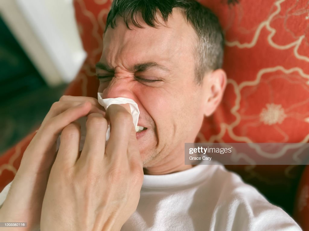 Close-Up of Man Wiping His Nose : Stock Photo