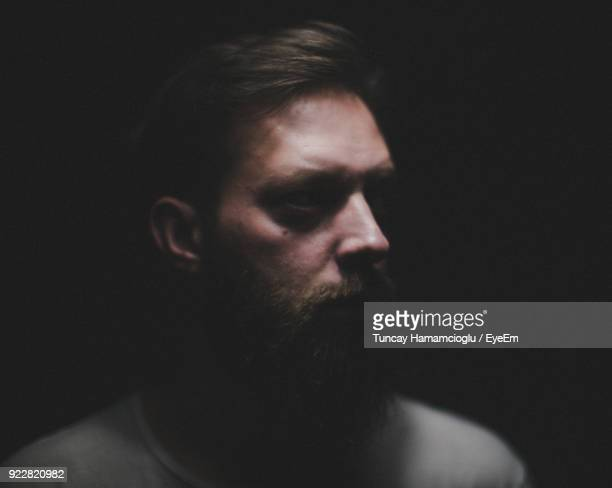Close-Up Of Man With Beard In Darkroom