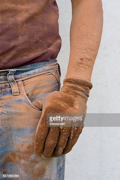 Close-up of man with dirty working glove