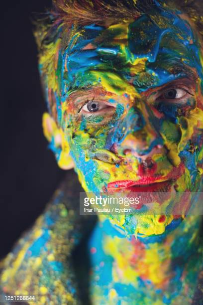close-up of man with face paint - body paint stock pictures, royalty-free photos & images