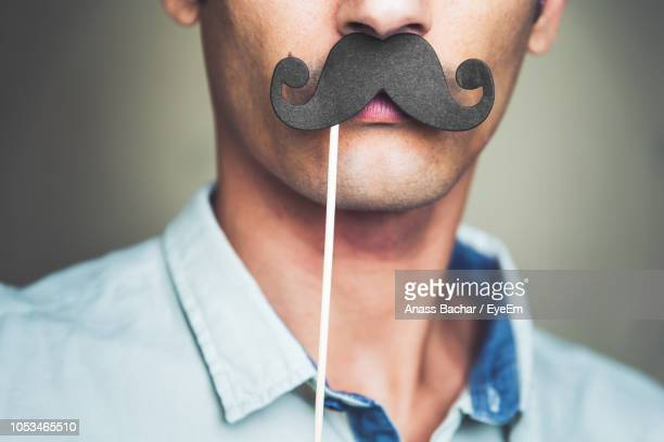 Close-Up Of Man With Mustache Prop