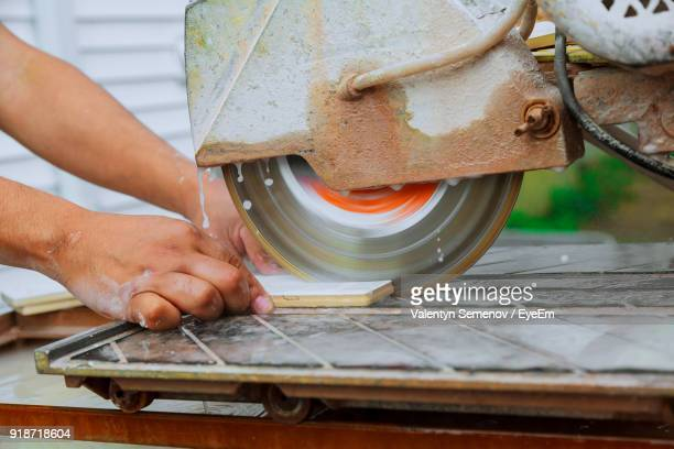 Close-Up Of Man Working At Machine