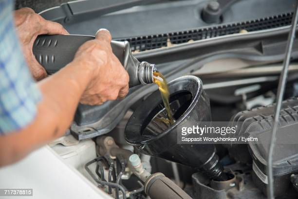 close-up of man working in car - car lubricants 個照片及圖片檔
