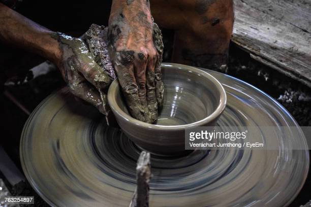 close-up of man working in mud - ceramic stock photos and pictures