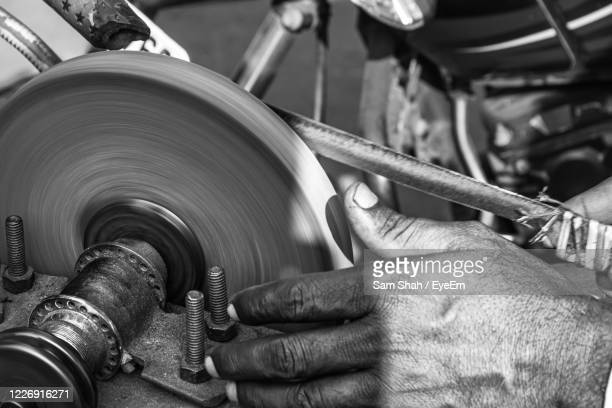 close-up of man working on machine - human body part stock pictures, royalty-free photos & images