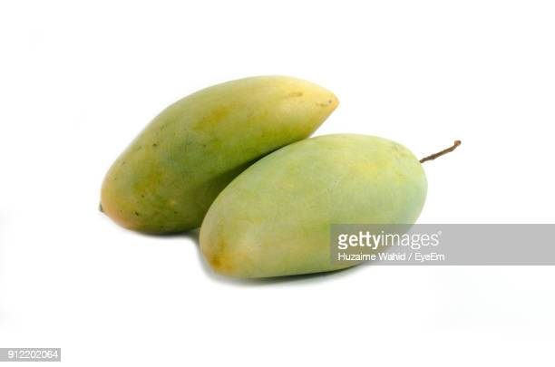 Close-Up Of Mangoes Against White Background
