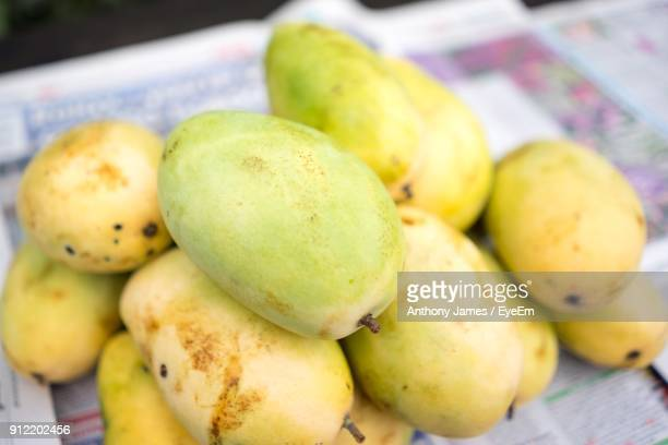 Close-Up Of Mangoes For Sale In Market