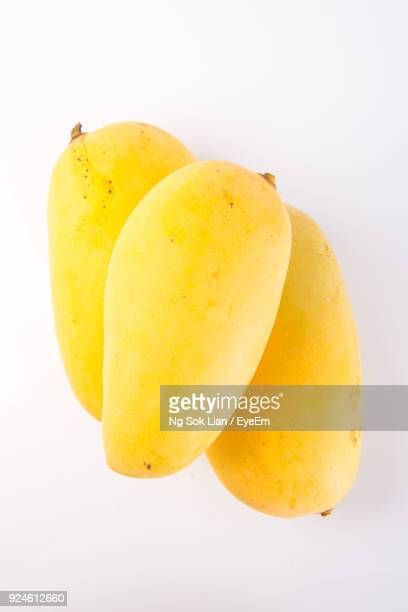 Close-Up Of Mangoes Over White Background