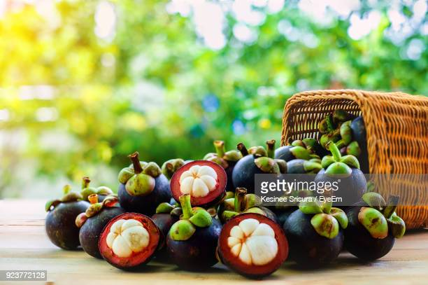 close-up of mangosteen fruits on table - mangosteen stock photos and pictures