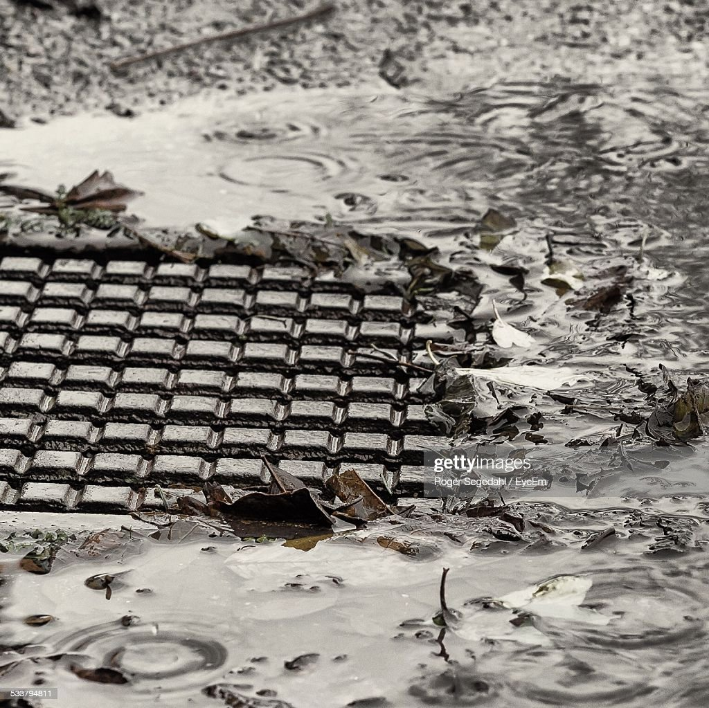 Close-Up Of Manhole During Rain : Foto stock