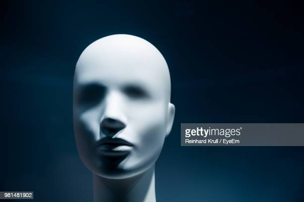 Close-Up Of Mannequin Against Black Background