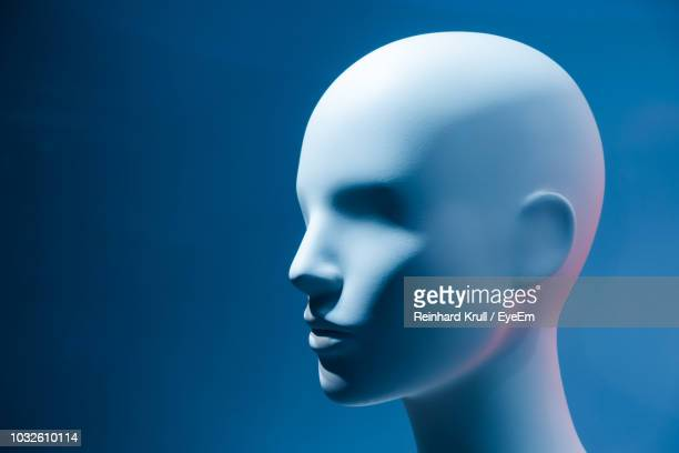 close-up of mannequin against blue background - mannequin stock pictures, royalty-free photos & images