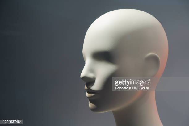 close-up of mannequin against gray background - mannequin stock pictures, royalty-free photos & images