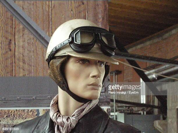 Close-Up Of Mannequin With Helmet And Eyeglass In Warehouse