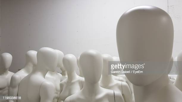 close-up of mannequins against wall - mannequin stock pictures, royalty-free photos & images