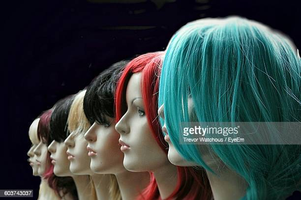 Close-Up Of Mannequins With Colorful Wigs At Store