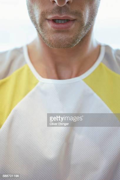 close-up of man's chest on chin - oliver eltinger stock-fotos und bilder